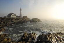 View Of Portland Head Light Lighthouse On Rocky Coastline During Sunrise