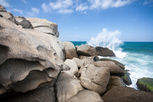 Scenic View Of Sea Waves Splashing On Boulders