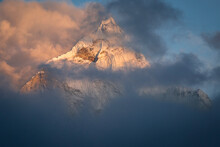 Scenic View Of Ama Dablam Peak Covered With Clouds During Sunset