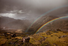 View Of Double Rainbow Spanning Sides Of Mountain