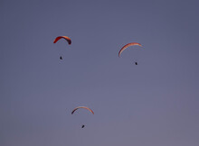 People Parasailing In The Sky