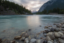 Scenic View Of Bow River At Dusk In Banff National Park