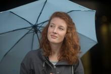 Young Woman Outside Umbrella L...