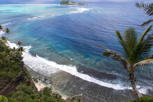 High Angle View Of Fringing Reef And Shoreline With Palm Trees