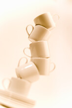 Coffee Cups Balance Precariously.