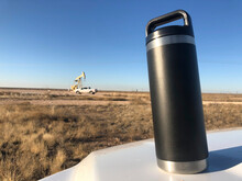 Coffee Thermos On Truck Hood W...