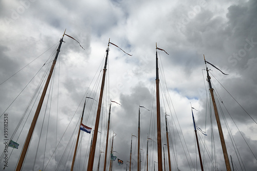 Foto The Dutch flag of the Netherlands flying on a mast of a saling ship