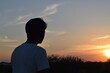 silhouette of a person in the sunset