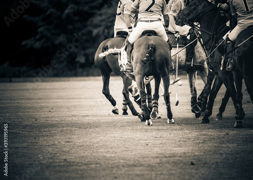 Players riding polo ponies in a polo match at Kirtlington Park, Oxfordshire Fotobehang