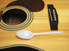 One-time Spoon On A Guitar, The Concept Of Making Money On Food. Closeup
