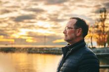 Outdoor Portrait Of Middle Age Man Enjoying Nice Sunset Over Lake