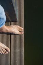 Feet Standing On The Bridge Edge