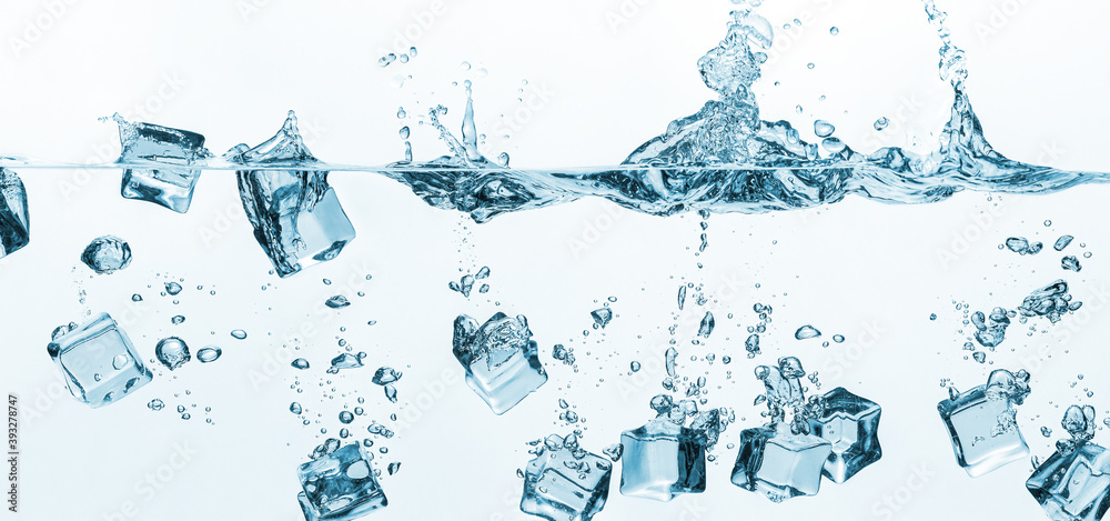 Fototapeta Falling ice cubes in water splashes isolated on white background. Ice cubes splashing into clear water surface view. Long wide banner