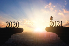 2021 Concept: Silhouette Of Year 2021 And Rooster On Mountain With City Sunset  Background