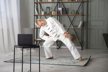 Woman Practice Tai Chi Chuan  And Conducts Online Training On The Laptop  In A Home. Social Distancing.  Webinar Recording. Online Communication.