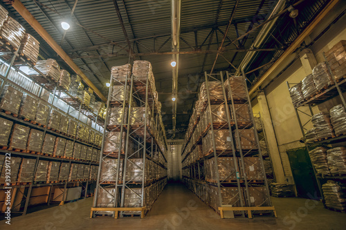 Picture of a big warehouse with many cardboard boxes on the shelves