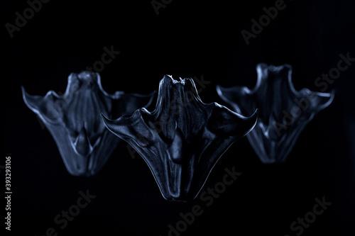 group of horned demons on a dark background. High quality photo Billede på lærred