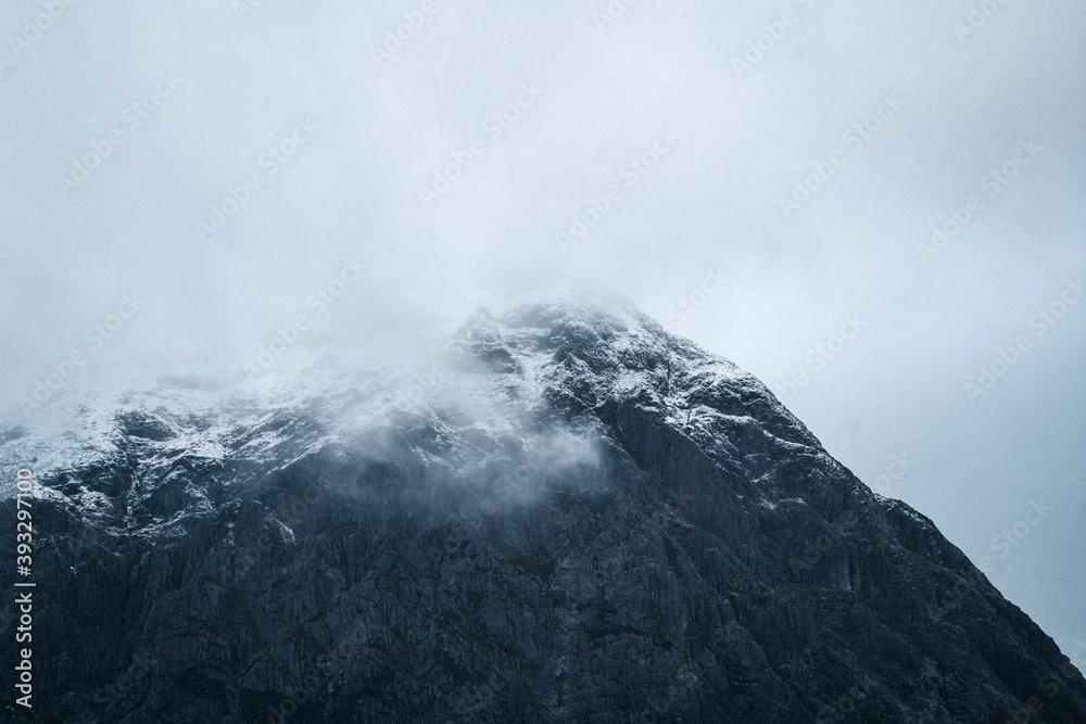 Fototapeta Snowy mountain on a misty day