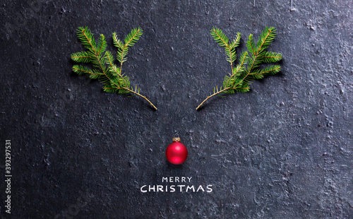 Christmas Concept - Reindeer Made With Fir Branches And Red Bauble On Black Stone