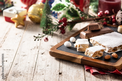 Fototapeta Assortment of Christmas nougat and marzipan on wooden table.Copy space obraz