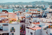 Beautiful Cityscape Of Ibiza With Colorful Houses And A Harbor On A Sunny Day