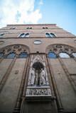 Marble statue of Quattro Santi Coronati by Nanni di Banco on the facade of Orsanmichele in Florence, Italy