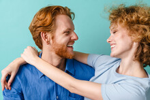 Young Happy Redhead Couple Hug...