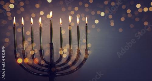 Fototapeta Religion image of jewish holiday Hanukkah background with menorah (traditional candelabra) and candles obraz