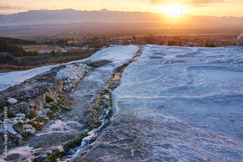 Travertine pools and terraces at sunset