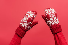 Cropped View Of Female Hands In Warm Mittens Isolated On Red
