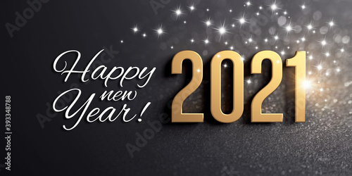 Happy New Year greetings and 2021 date number colored in gold, on a festive black card, with glitters and stars
