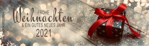 Christmas New Year greeting card 2021 with text in German - Frohe Weihnachten und ein gutes neues Jahr 2021 -Christmas present with red bow