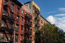 Row Of Colorful Old Residential Buildings With Fire Escapes In The East Village Of New York City