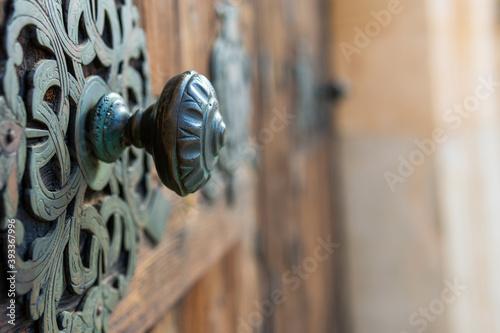 Fotografie, Obraz Detail of an antique door handle made of bronze
