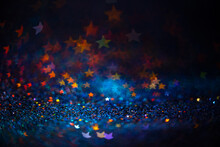 Festive Twinkle Lights Background, Abstract Sparkle Backdrop With Stars, Modern Design Overlay With Sparkling Glimmers. Blue, Orange And Green Backdrop Glittering Sparks With Blur Effect