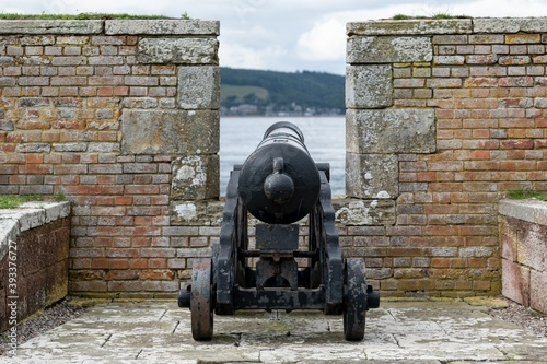 War cannon at barracks complex in historical Fort George behind a protective wal Fototapeta