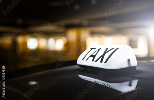 taxi in the city - order by apps - dark background Poster Mural XXL