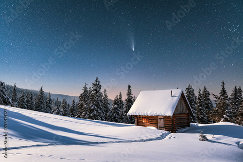 Fototapeta Fantastic winter landscape with wooden house in snowy mountains