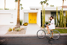 USA, California, Palm Springs, Woman On Bicycle On The Street