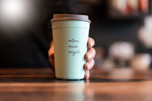 Hand Holding Deposit Cup For C...