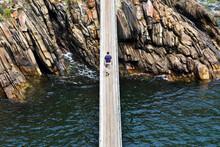 Africa, South Africa, Western Cape, Paarl, Garden Route National Park, Tsitsikamma National Park, Man Walking On Wooden Bridge