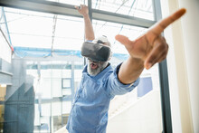 Businessman Wearing VR Glasses At The Window