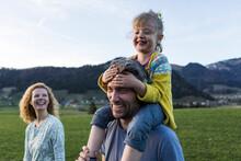 Austria, Tyrol, Walchsee, Happy Family Hiking On An Alpine Meadow