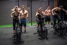 Men Motivating Women Exercisin...