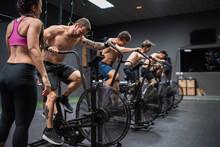 Athletes Sitting On Bike While...