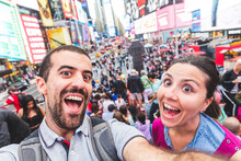 USA, New York, Selfie Of Happy Couple In The City At Times Square