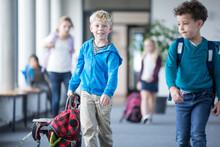 Schoolboy With Classmates Leav...