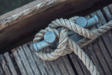 Close-up Of Rope Tied To Cleat On Houseboat