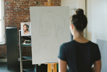 Artist Sketching On A Canvas