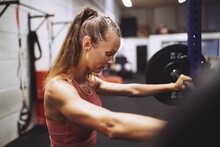 Fit Mature Woman Weightlifting...